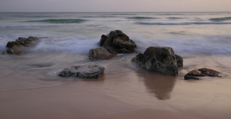 Boulders and waves. Canon 7D with Canon 10-22mm lens at ISO 100. 1.3 seconds at f/14.