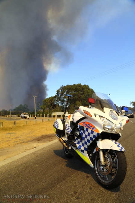 Police road block as a bushfire rages at Banjup, Western Australia.