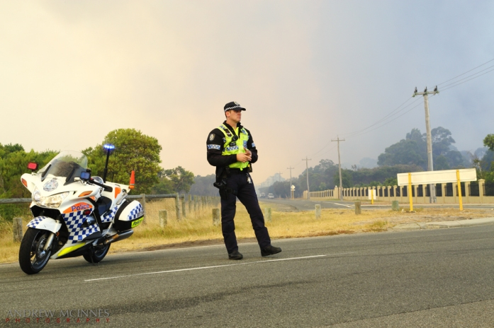 Police road block as a bushfire rages at Banjup, Western Australia.